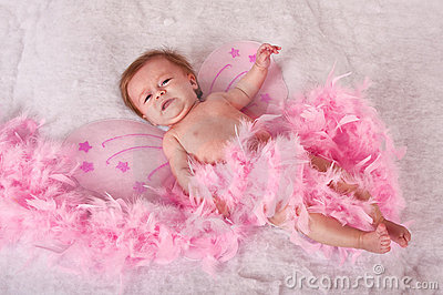 Baby girl with pink fairy wings
