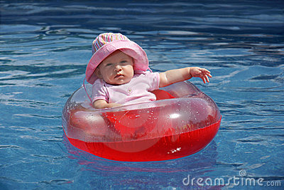 Baby girl in plastic boat