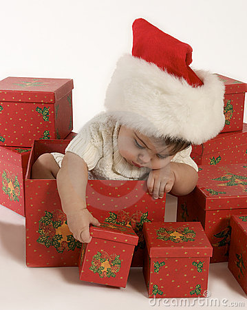 Baby girl playing with christmas boxes