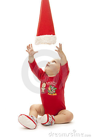 Baby girl playing with a crismas hat