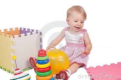 Baby girl playing toys