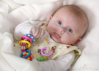 Baby girl with rattle