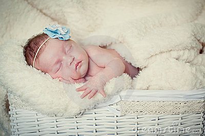 Baby girl sleeps on a blanket