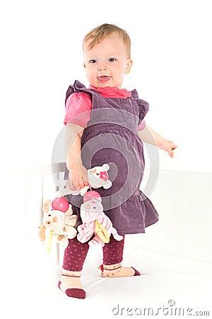 Baby girl standing on crib