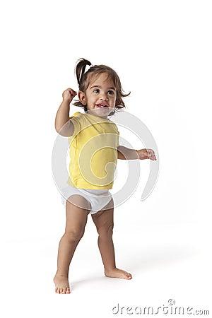 Baby girl standing in the studio