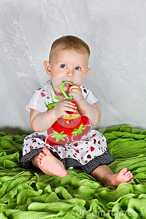 Baby girl and the strawberry s dress