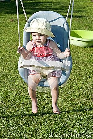 Baby girl on swing