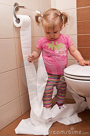Baby girl with toilet paper