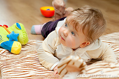 Baby girl with toys