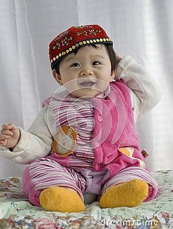 Baby girl in Uigur dress