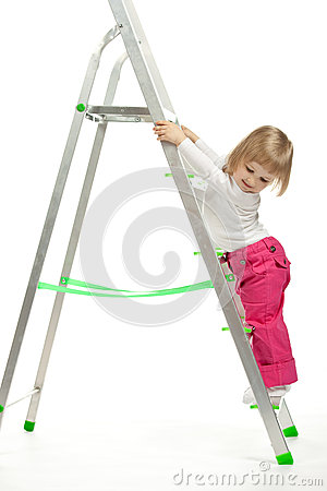 A baby girl walking down the stepladder