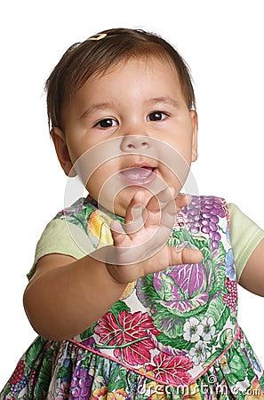 Baby girl waving hello