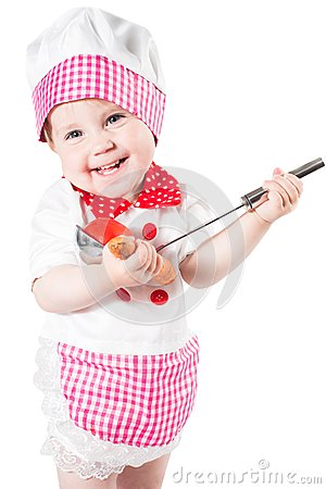 Baby girl wearing chef hat with vegetables and pan isolated on white background.The concept of healthy food and childhood