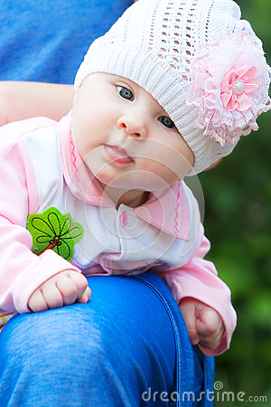 Baby Girl Wearing Knit Hat with pink Flower