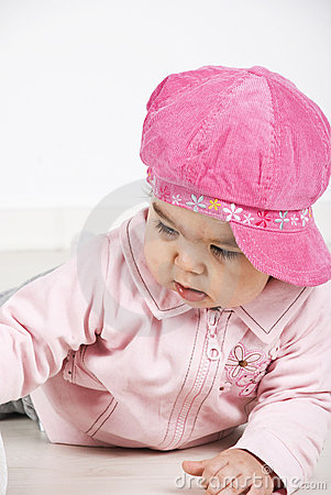 Free Baby Girl With Pink Cap Lying Down Royalty Free Stock Images - 14077619