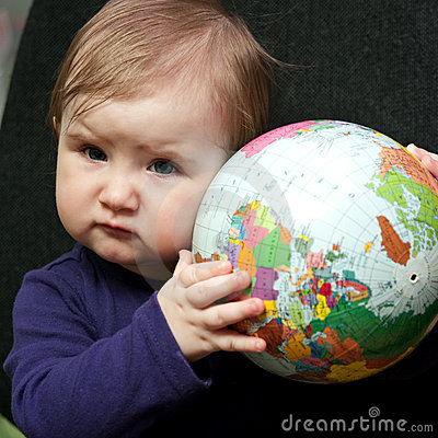 Baby girl with world globe