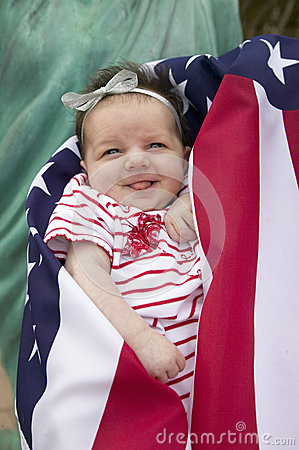 Baby  girl wrapped in American flag Editorial Photography