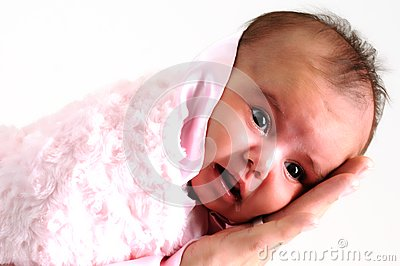 Baby girl wrapped in pink blanket held by father