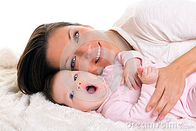 Baby girl yawning open mouth with mother care near