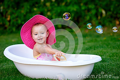 baby girl 1 2 year old taking bath with soap foam outdoors stock photo image 63228450. Black Bedroom Furniture Sets. Home Design Ideas