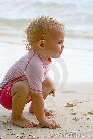 Baby grabbing sand