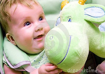 Baby with green soft toy