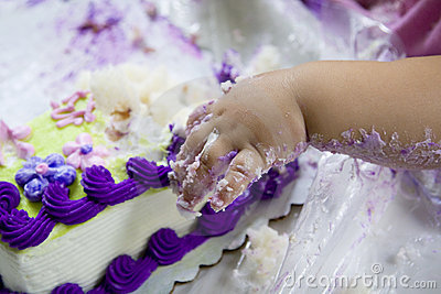 Baby hand in cake