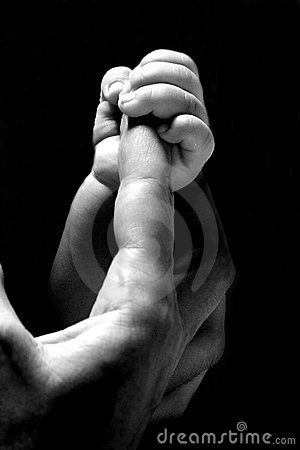 Baby hand holding a finger
