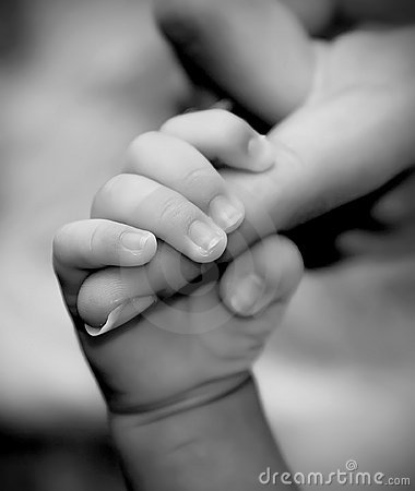 Baby hand holding mother s finger