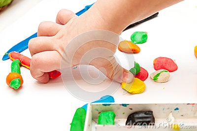 Baby hands with plasticine