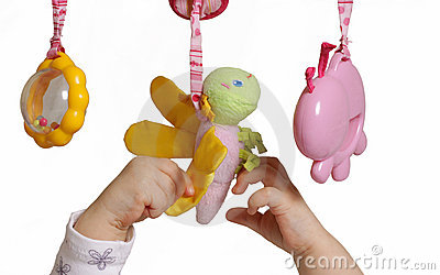 Baby hands with toys