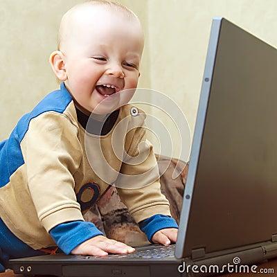 Baby having fun with laptop