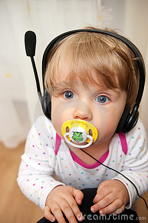 Baby with headset pacifier
