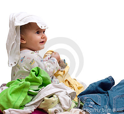 Baby in heap of wear
