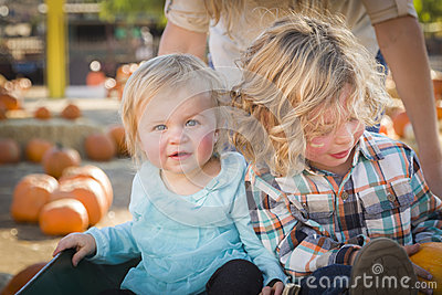 Baby and Her Brother at the Pumpkin Patch