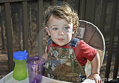 Baby in a Highchair Outdoors