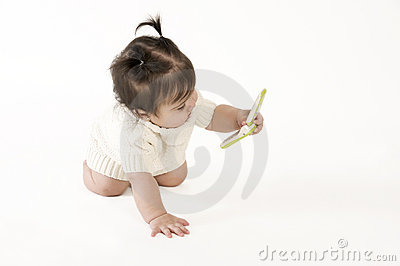 Baby holding cell phone