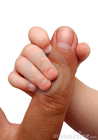 Baby holding father finger