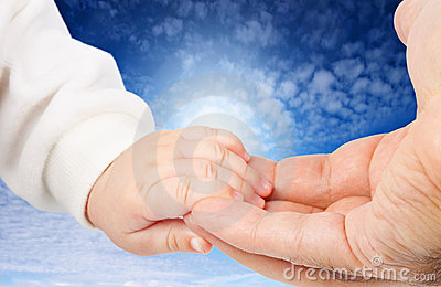 Baby holding father s hand