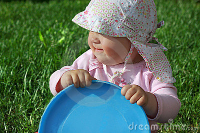 Baby holding frisbee