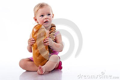 Baby holding a loaf of bread in roll beads