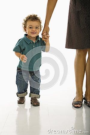 Baby holding mom s hand.