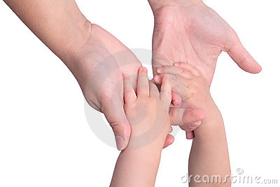 Baby holding mothers hands