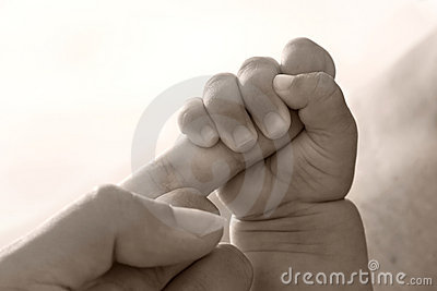 Baby holding parent hand