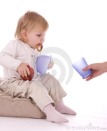 Baby holding red apple cake bowl