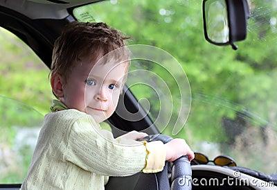 Baby holding steering wheel