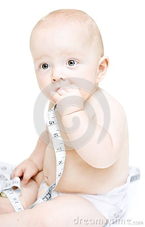 Baby holding tape measure