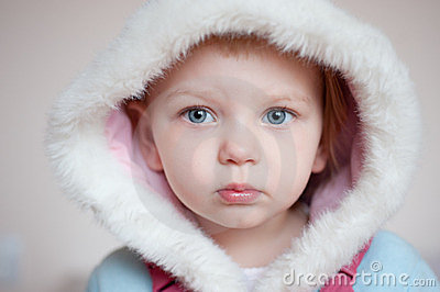 Baby with hood. closeup