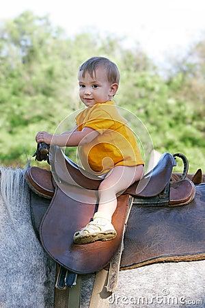 Baby on horseback