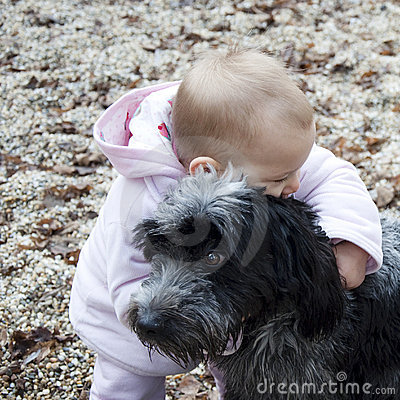 Baby hugging dog.